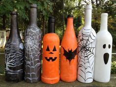 Halloween bottle decorations...i like the first one with the tree and moon