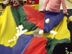 Superlative article on Parachute play and the many ways to use it with young children (outlines benefits for children w special needs, too) Clever parachute game for Itsy Bitsy spider to cross midline!