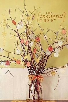 Grab some twigs, cut up some scrap paper and make a grateful tree for the center of your Thanksgiving table!