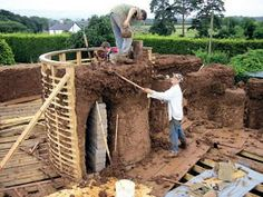 The building of a cob house.