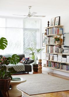 tiny house decorating inspiration - built in bookshelves from floor to ceiling. /