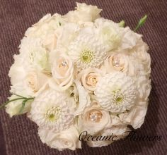 All white bridal bouquet with crystal pins