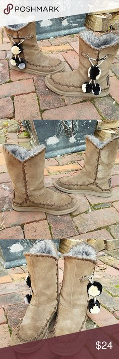 Size 9 Juicy Couture suede boots Brown suede slip on boots are super cute! Exterior stitching, adorable pom-poms hang from the sides, faux fur lining. Minor wear, no holes, or flaws. These are very comfy,  great for the Fall and winter Juicy Couture Shoes Ankle Boots & Booties