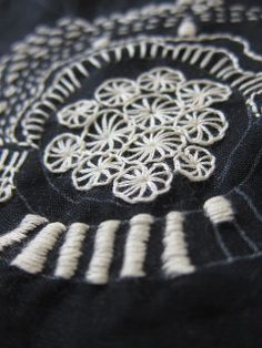 Monochrome embroidery with high contrast stitching; sewing idea; decorative textiles design
