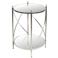 Elegant accent table with nickel-plated stainless steel and brass base with a mirror glass top.   <br><br><ul> <li>28 inches high x 20 inches in diameter</li> <li>Silver color</li> <br \> <br \> <ul \>...