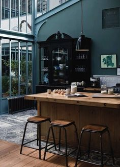 cool buffet! Mix of items: wooden island, industrial stools. Awesome! And i think id like to have the bottom cabinets this wall color, if not dk grey. What wld you call this. Dark petrol.. Dark grey with a splash of turquoise?