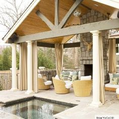 Love the open gables, outdoor living space with in-ground pool/hot tub and outdoor fireplace. Compact but spacious- excellent!