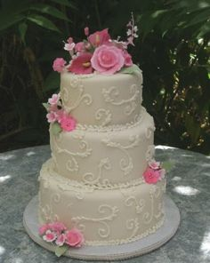 I like this one - I would just add ribbon around the bottom of the tiers and some green and orange.