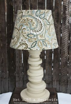 Another Scrap Wood Lamp | Not JUST A Housewife. This would be cute to paint the circles different colors to match the room colors.