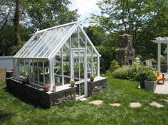 Love the glass green house with adjoining fire place