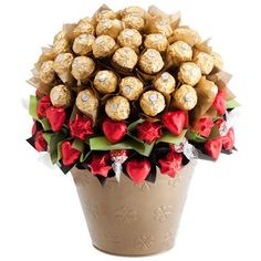 Featuring 90 gourmet chocolates in a lavish bouquet arrangement, this striking bloom will impress even the most pampered gift recipient! An abundance of Ferrero Rocher chocolates adorn a bed of Lindt balls and Belgian chocolate hearts to form a deluxe bloom that will not soon be forgotten. Includes: 50 Ferrero Rocher chocolates, 10 milk chocolate Lindt balls, 30 solid Belgian milk chocolate hearts from Chocolatier, Keepsake Gold bucket, Complimentary gift wrapping and gift card.
