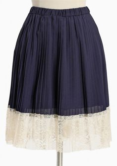 """Charming Accents"" Pleated Skirt: Sweetly adorned with delicate cream lace, this navy pleated skirt in chiffon exudes graceful elegance. Finished with a charming raw edge and an elasticized waist. Fully lined. $35.99"