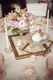 Centerpieces using vintage frames and glassware – each table similar but not the same – so beautiful.