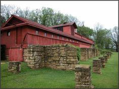 These barns have had many forms over the years. The most recent incarnation was built between 1938 and 1947. These were used as barns for the Taliesin apprentices for the work they did on the fields on the property. They contained dairy barns, pig pens and storage for the farm equipment. The home built by Richard Lloyd Jones was moved up the hill and incorporated into the barns.
