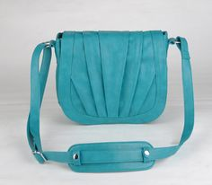 Camera bag. Can't decide what color I like best: pewter, black, or teal? $87 (+ $14 for shipping = $101) --getting new stock this spring (black)
