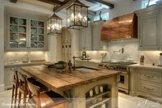layout, windows above cabinets, beams, lighting & cabinet color!
