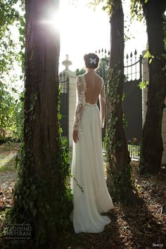 Love the lace sleeves and open back with the bow in her hair ~ Berta Wedding Dresses 2014 Love. Love. Love!