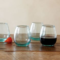 """FIRESIDE WINE TUMBLERS, SET OF 4--Handblown of subtly green recycled glass, these generously curved wine tumblers celebrate the season in an eco-friendly way. Made in Colombia. Dishwasher safe. Set of 4. Each 8 oz., 5-3/4""""H."""