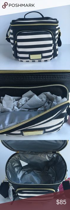 """Betsey Johnson Lunch Cargo Tote Bag Purse Stripe Eat lunch in style! 🍕  Details:  • Synthetic (faux leather) material • Rectangular gold tone plate on front with engraved Betsey Johnson logo • Zippered front pocket  • Removable/adjustable strap  • Top Handle • Top insulated zippered compartment with heart-shaped zipper pulls   Product Dimensions: 9""""W x 7.5""""H x 7.5""""D    🚫NO TRADES🚫😊 Betsey Johnson Bags Shoulder Bags"""
