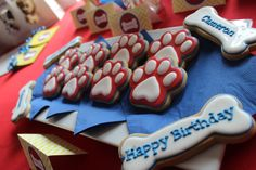 Paw and bone shaped cookies for Paw Patrol birthday by The Baked Equation!