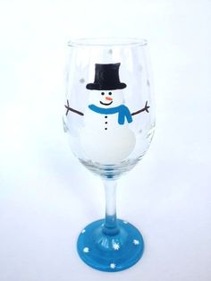 Snowman hand painted wine glass by CrystalsGlassDesigns on Etsy #snowman #winter #wine #wineglass