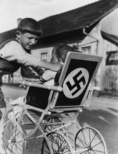 Swastika Stroller in a Lower Bavarian Village it came to Hitler portraits and other Nazi symbols, no article from everyday life was off-limits. Symbols of loyalty and unity were supposed to help Nazi propaganda to permeate all areas of life. Nagasaki, Hiroshima, Fukushima, Nazi Propaganda, Weird Vintage, The Third Reich, World War Ii, Wwii, Vintage Photos