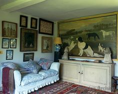 Robert Kime ~ A large painting of dogs and horses above a sideboard dominates this small sitting room