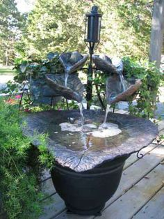 Pictures of cast cement leaf fountains to inspire you!