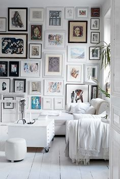 Wall collage in white room...