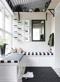 Organized mudroom or entry area. Love so many aspects of this space: padded bench seating to sit & put shoes on or take them off (& step on to access overhead shelf), individual little shelves for sunglasses to keep from getting scratched, overhead shelving & a mirror to check yourself out before you head out the door.