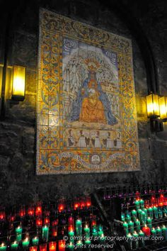 Basilica at Montserrat, Spain. The Path of Ave Maria. This corridor between the rock face and the church has a fountain, and an unbelievable number of candles.