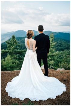 Bride and groom at Old Edwards Inn in Highlands, NC. Wedding dress by Naeem Khan. Image by Cameron Reynolds Photography.