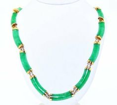 (http://shop.shinjewelers.com/32000310-14k-yellow-gold-authentic-jade-necklace-with-box-lock/)