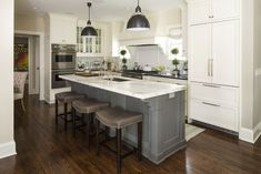 Fabulous White Kitchen with Gray Island by Martha O'Hara Interiors