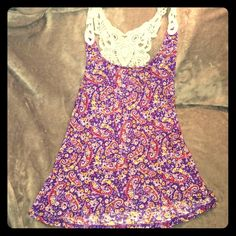 Cute Floral Tank Top This tank top is super cute, but was too small for me. It has a adorable crotchet detailing on the back. The purple color is also beautiful. Arizona Jean Company Tops Tank Tops