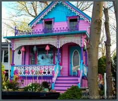 beach cottage ideas Not sure if I would call this Barbie and Ken's house or Hansel and Gretel's house. Actually there are a number of these brightly painted homes in Grimsby Woman Painting, House Painting, Hansel And Gretel House, Purple Painted Lady, Painted Ladies, Pink Purple, Case Creole, Rainbow House, Pink Houses