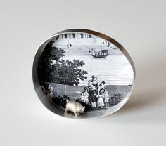 "Nikolai Balabin-  RUSSIA    Dream of The North, brooch, 2007, silver, print on paper, plastic, paint, 61 mm  ""My Park    Miniature plays about the real and imaginary life, park as stage."""