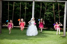 Rainbow Wedding.  Having fun on the swings with Blue Whale's bridesmaids | Brenda Upton Photography