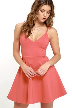 Your future love will never know what hit 'em when you stroll by in the Meet Cute Coral Red Skater Dress! Medium-weight stretch knit shapes a darted bodice with a V neckline, supported by skinny straps. Flaring, mini-length skirt. Hidden back zipper.