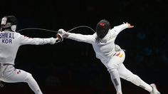 Britta Heidemann (R) of Germany battles against A Lam Shin of Korea (L) in the Women's Epee Individual Fencing Semifinals on Day 3 of the London 2012 Olympic Games at ExCeL.