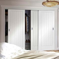 Bespoke Thruslide Suffolk Flush White Primed 3 Door Wardrobe and Frame Kit - Lifestyle Image. #slidingdoors #whtieslidingdoors