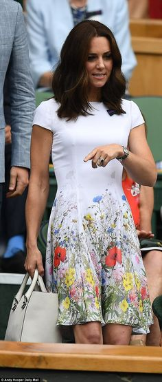 The Duchess donned another white dress to attend the men's singles final at Wimbledon on Sunday