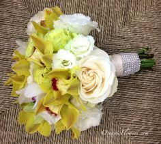 Yellow, White, and Lime Green Bridal Bouquet with Crystal Wrap.   Flowers of Charlotte loves this! Find us at www.charlottewedd... for more information on weddings and events in Charlotte, NC