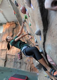 A student climbs the rock wall at the Rec.