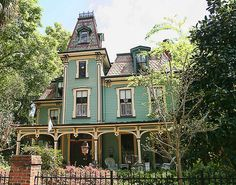 A tower, beautiful porch, adorable windows and haunted? No but this is usually the type of Victorian home that is depicted in movies when they are looking for an old haunted house archetype. This is the Second Empire style and I love it--I think a there's enough room for me and a ghost.