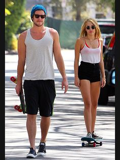 Miley & Her Man Liam Hemsworth - her outfit and glasses - WTF? Seriously, could her shirt be tucked in any tighter? Not too mention that is NOT the right way to wear a colored bra under a white shirt!!  Sorry Miley, WTF? Liam - so cute!