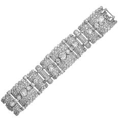 Important Art Deco Diamond Platinum  Bracelet. Platinum Art Deco Bracelet with Approximately 40.00cts of Old European Cut and Baguette Cut Diamonds Being G-I in Color and VS-SI in Clarity.