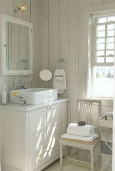 maybe horizontal whitewashed pine paneling halfway up wall in downstairs bath