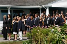 The family and friends of the late Sen. Edward Kennedy, watch as his casket is moved to a hearse at the Kennedy compound in Hyannis Port, Massachusetts on August 27, 2009.