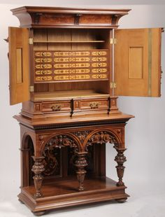 Late 19th century Renaissance Revival carved and Inlaid German cupboard